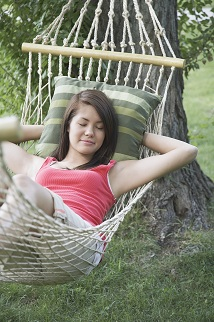 Woman napping in hammock