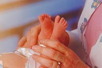 Picture of a nurse examining a newborn