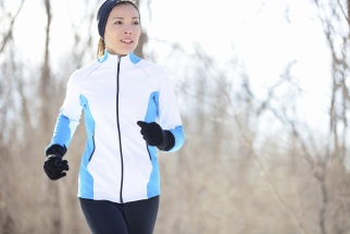 Woman jogging outdoors in cold weather