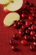 Cranberries and an apple