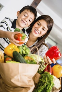 Mother and son looking at vegetables
